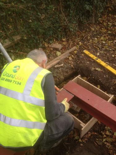 Bromley installing steel beams on screw pile caps
