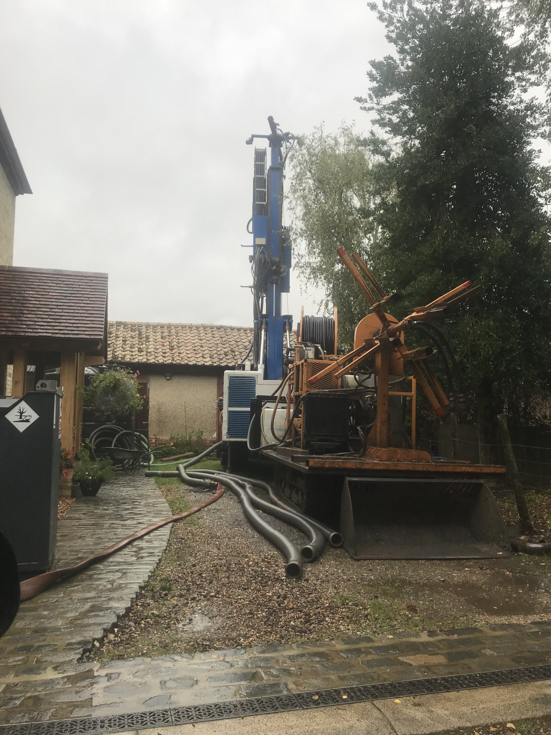 ground source heat pump drilling in small drive way tight space